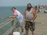Some nice tourists, from Tennessee, fishing off the Kure pier.